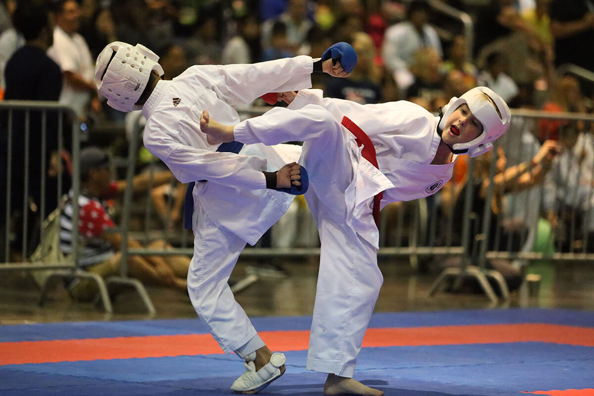 Two boys in a karate tournament